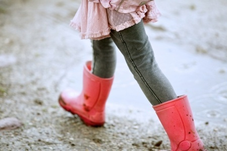 Closeup of Little Girl in Red Boots by Michael Simons